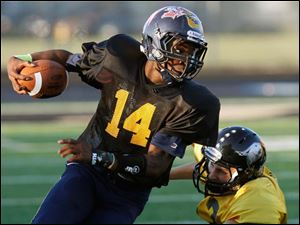 Black Squad receiver Alonzo Lucas (14) of Whitmer High School runs the ball against the Gold Squad during the 22nd annual Regional All-Star Football Game Friday.