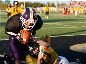 Black Squad receiver DeVonte Hughes (82) of Waite High School scores a touchdown against Gold Squad defender Jon Angelone (27) of Gibsonburg High School during the 22nd annual Regional All-Star Football Game Friday.