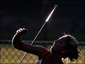 Perrysburg twirler Hannah Williamson, 17, practices for the halftime show during the 22nd annual Regional All-Star Football Game Friday.