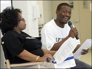 "Coleena Ali, left, and Greg Braylock, Jr., right, lead the discussion about aspirations for the Central City Community during a ""We Are Toledo: A Community Gathering "" event sponsored by United Way at Scott High School."