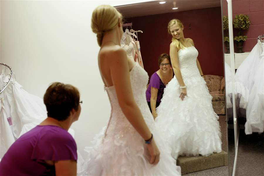 on a moonlight wedding dress at dream designs bridal outlet in toledo