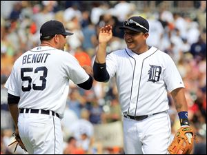 Detroit Tigers third baseman Miguel Cabrera high-fives relief pitcher Joaquin Benoit (53) after their 6-4 win over the Chicago White Sox in a baseball game in Detroit today.