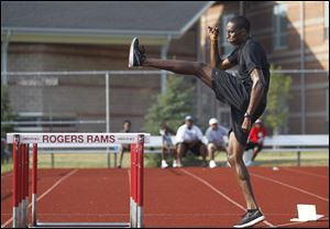 Erik Kynard trains earlier this month at Rogers High School where he became a two-time state champion high jumper. He finished in the top three at the U.S. Olympic trials to go to the Games.