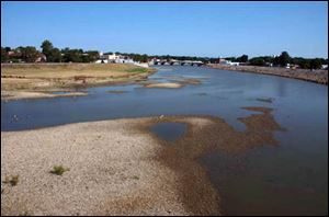 A dry summer and ongoing drought have dropped the water level in the Sandusky River at Fremont.
