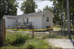 Crime-scene tape surrounds the residence in Perrysburg Township where Leandra Dominique Frankum Frankum was killed.
