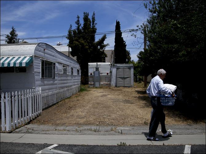 Endangered Trailer Park Ralph Meyers, 86, walks to a laundry room at the Santa Monica Village Trailer Park in Santa Monica, Calif. The city's Planning Commission recently recommended the 3.8-acre park's zoning be changed to allow a developer to bulldoze its modest, rent-controlled homes and replace them with nearly 200 much-higher-priced apartments and condominiums, as well as more than 100,000 square feet of office and retail space.