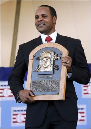 Former Cincinnati Reds star Barry Larkin holds his plaque after his induction into the National Baseball Hall of Fame and Museum during Sunday's ceremony in Cooperstown, N.Y.