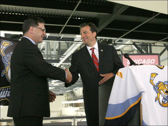 SPT walleyephoto06p Mark Bernard, the Chicago Blackhawks general manager of minor league affiliations, left, while announcing an affliation agreement with the Toledo Walleye on Aug. 5, 2009. Bernard said the relationship has been mutually beneficial.
