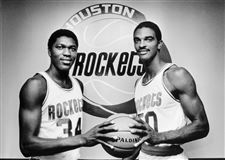 Basketball-Stars-Akeem-Olajuwon-and-Ralph-Sampson-Holding-Basketball