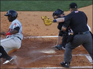 Indianapolis' Brandon Boggs slides safely into home when Hen cather Bryan Holaday was too late on the tag.