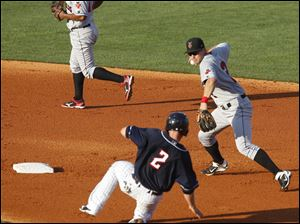 Hen Bryan Holaday is outed on a double play at 2nd base by Indianapolis' Chase d'Arnaud.