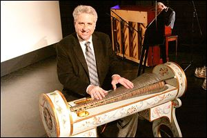 Musician Dennis James with his glass armonica.