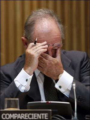Rodrigo Rato, former chairman of the Spanish bank Bankia and Spain's former deputy prime minister, pauses during a parliamentary hearing in Madrid. High borrowing costs are crippling Spain's economy.