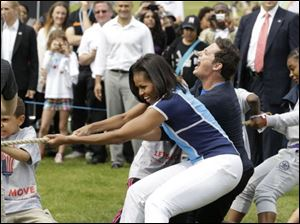 Michelle Obama plays with schoolchildren during a 'Let's Move!' event at the U.S. ambassador's residence in London, ahead of the 2012 Summer Olympics