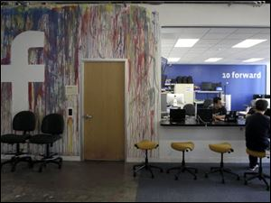 This photo shows workers at the Facebook office in Menlo Park, Calif.