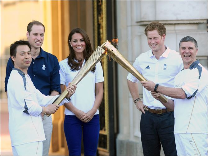London Olympics Prince William, his wife, Catherine, and Prince Harry watch Wai Ming Lee, from a charity of which Prince Harry is a patron, hand over the torch to John Hulse, of a charity of which Prince William is a patron, at Buckingham Palace.