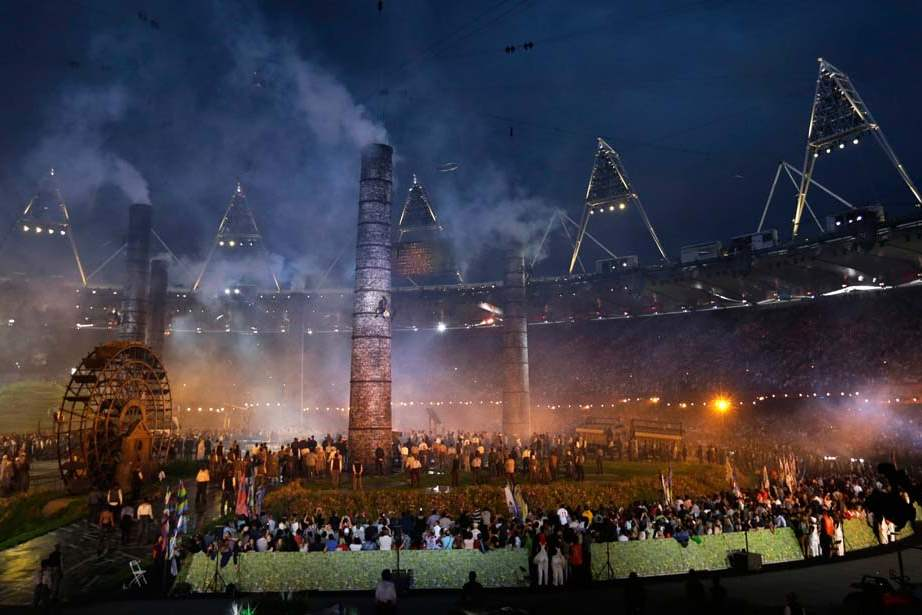 Actors-scale-chimneys-during-a-performance-at-the-Opening-Ceremony