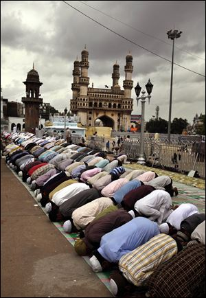 Indian Muslims offer first Friday prayers during Ramadan at Mecca Masjid in Hyderabad, India. Observers fast from dawn to dusk.