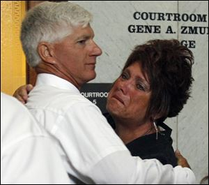 Jeff Straub, father of the murdered Lisa Straub, 20, embraces his sister-in-law Karen Verbosky after guilty verdicts were announced against Samuel Williams, 24, in Lucas County Common Pleas Court.