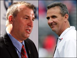 Wisconsin coach Bret Bielema, left, and Ohio State coach Urban Meyer.