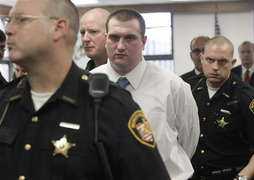 Samuel-Williams-is-escorted-from-the-courtroom-by-Lucas-County-sheriff-s
