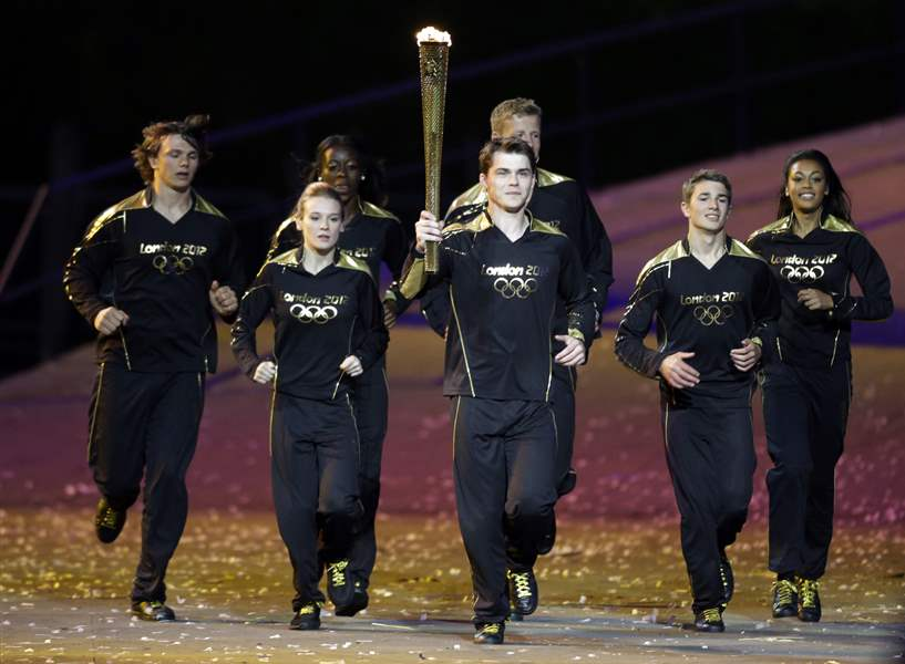The-Olympic-torch-enters-the-stadium-to-light-the-flame