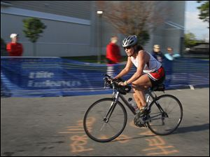 Tracy Evans of Perrysburg starts out on the 11-mile bike ride portion of the triathlon.