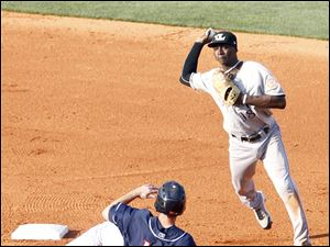 Toledo's Justin Henry tries to break up a double play while sliding past Louisville second baseman Didi Gregorius.