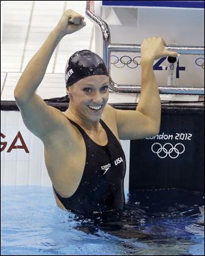 USA's Dana Vollmer won an Olympic gold in the 100 meter butterfly with a world-record time of 55.98 seconds.