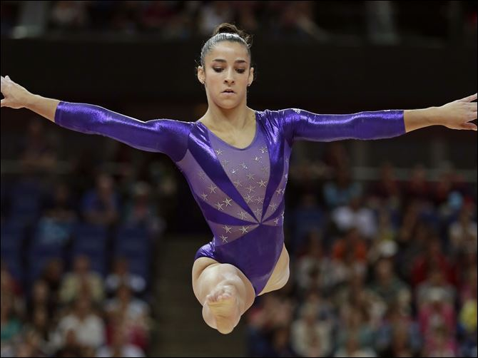 London Olympics Artistic Gymnastics Women Aly Raisman helped the U.S. women's gymnastics team finish in first after qualifying. The U.S. must overcome shock though as Raisman edged world champ Jordyn Wieber to reach the all-around finals.