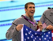 USA-s-Michael-Phelps-celebrates-with-his-Gold-Medal