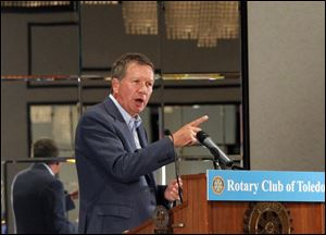 Gov. John Kasich speaks to members of the  Rotary Club Of Toledo during their meeting at the Park Inn Hotel.