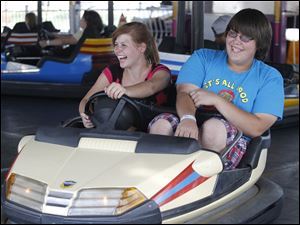 Wayne residents Josie Alexander and Gavin Alva, both 15, enjoy the bumper cars.