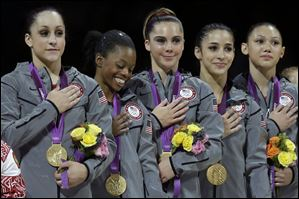 U.S. gymnasts, left to right, Jordyn Wieber, Gabrielle Douglas, McKayla Maroney, Alexandra Raisman and Kyla Ross stand for their national anthem, during the Artistic Gymnastics women's team final at the 2012 Summer Olympics on Tuesday.