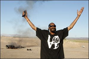 Snoop Dog blows up an armored truck to commemorate the 10 millionth visitor to Zynga's  Mafia Wars: Las Vegas.