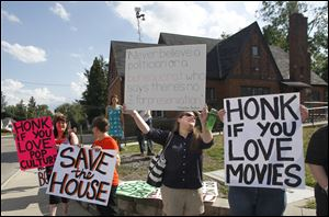 Demonstrators outside Bowling Green State University's Popular Culture House show their support for the venerable structure, which the university plans to demolish. The house was bought as a kit in 1932.