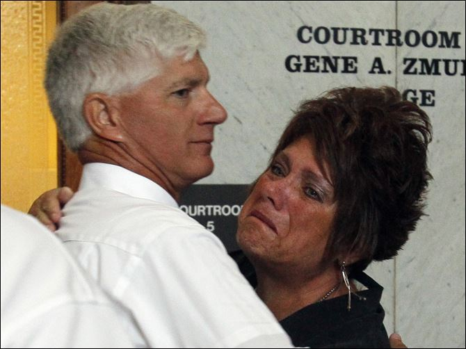 CTY williams28p Jeff Straub, father of victim Lisa Straub, with Karen Verbosky, his sister-in-law, after the verdicts are announced.
