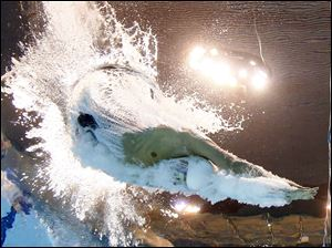 United States' Ryan Lochte starts in a men's 200-meter individual medley at the Aquatics Centre in the Olympic Park Wednesday.