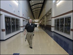 Lake Schools Superintendent Jim Witt walks between the new trophy cases in the main hallway during the media tour.