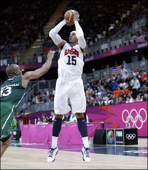 USA's Carmelo Anthony (15) shoot a jumper over Nigeria's Derrick Obasohan (13) during a preliminary men's basketball game at the 2012 Summer Olympics, Thursday.