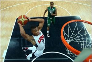 Russell Westbrook (7) of the United States shoots against Richard Oruche (11) of Nigeria during a men's basketball preliminary round match at the 2012 Summer Olympics.
