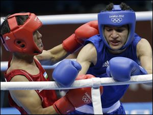 Uzbekistan's Jasurbek Latipov, left, fights Egypt's Hesham Abdelaal during a men's flyweight 52-kg preliminary boxing match.
