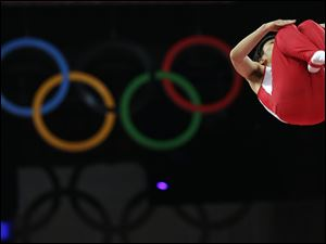 Japan's Masaki Ito performs during the men's trampoline qualification.
