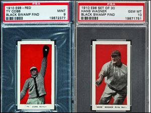 A 1910 Ty Cobb baseball card, left, and a 1910 Honus Wagner card were among 37 cards from a collection found in Defiance that were auctioned Thursday in Baltimore.