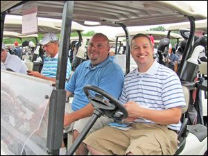 Heartbeat Golf Outing. The Clark team: Brian Grime and Jay Stricker.