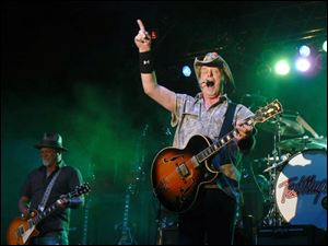 Ted Nugent performs at the 28th Northwest Ohio Rib-Off at the Lucas County Fairgrounds in Maumee  in front of more than 11,000.