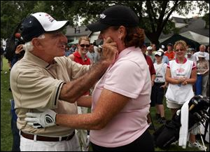 Jamie Farr and Meg Mallon joke around during the pro-am event in 2005. The former Ohio State golfer won four major tournaments.