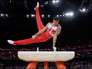 Britain's gymnast Louis Smith  performs during the artistic gymnastics men's pommel horse finals.