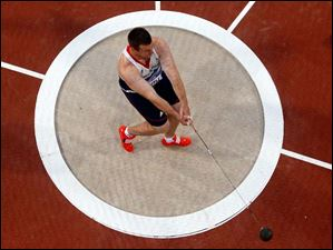 Britain's Alexander Smith competes in the men's hammer throw final.