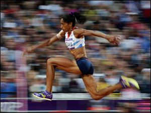 Britain's Yamile Aldama competes in the women's triple jump final during the athletics in the Olympic Stadium.